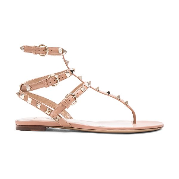 Valentino Leather rockstud flat sandals in neutrals - Leather upper and sole.  Made in Italy.  Rubber tap...