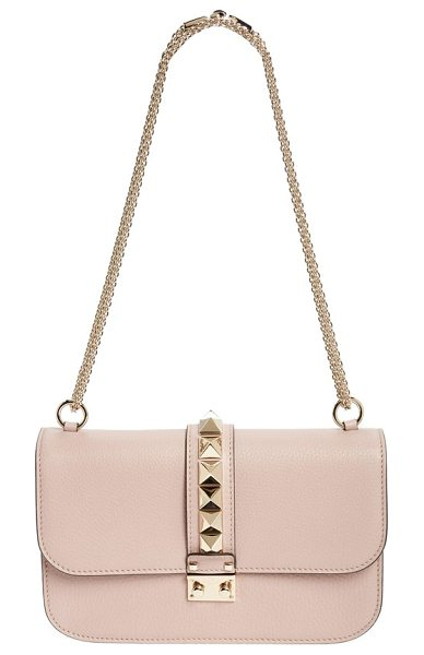 Valentino medium lock studded leather shoulder bag in poudre - A row of gleaming pyramid studs highlights the sleek...