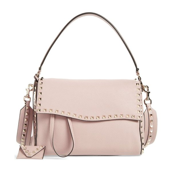 Valentino medium rockstud leather shoulder bag in poudre - Polished rockstud trim provides an iconic finish for an...