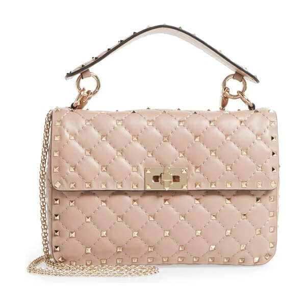 Valentino medium rockstud matelasse quilted leather crossbody bag in pink - Micro pyramid studs spike the meticulous matelasse...