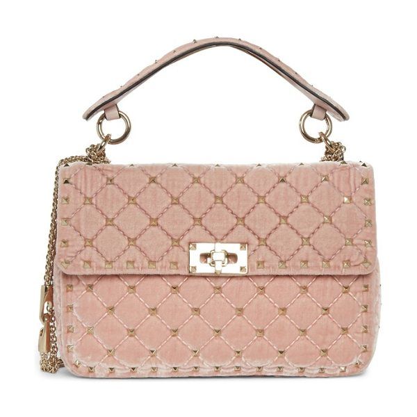 VALENTINO medium rockstud matelasse velvet shoulder bag in pink - Micro pyramid studs highlight the matelasse detailing of...