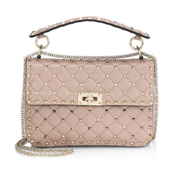 Valentino medium rockstud quilted top handle bag in poudre - Signature rockstuds add attitude to this quilted leather...