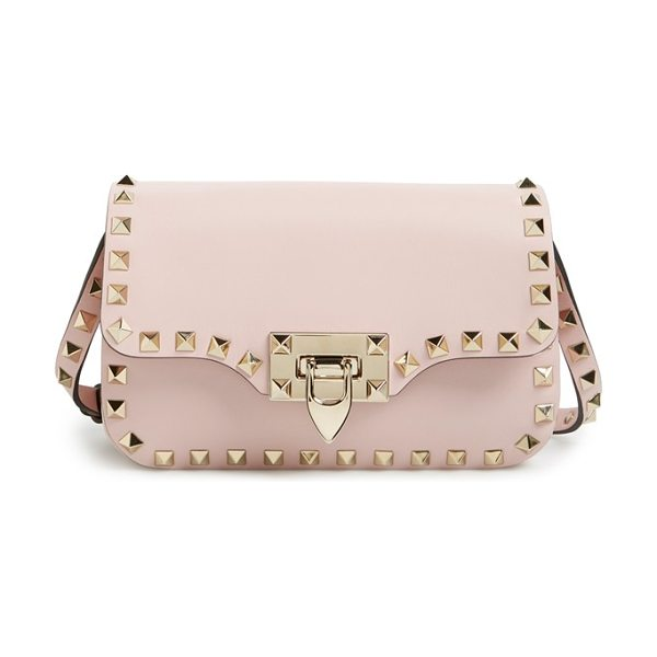 VALENTINO 'mini rockstud' crossbody bag in water rose - Signature rockstuds trace the clean, modern profile of a...