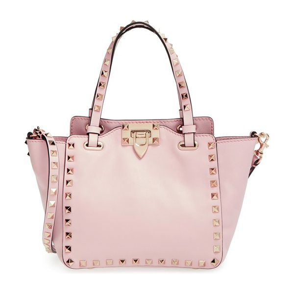 VALENTINO Mini rockstud leather tote - Signature rockstuds frame the iconic silhouette of a...