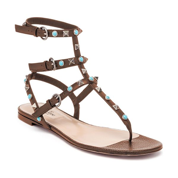 Valentino multi-studded leather gladiator thong sandals in brown - Boho-chic studs color signature leather sandal. Studded...