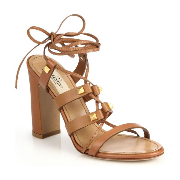 Valentino Rockstud leather lace-up sandals in cognac - Beautifully crafted lace-up gladiator sandals with a...