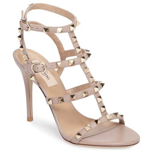 Valentino 'rockstud' ankle strap sandal in beige - Valentino's signature gilded pyramid studs add edgy...