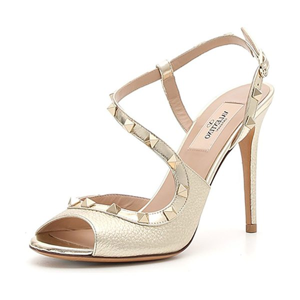VALENTINO Rockstud Asymmetric Metallic Sandal in silver - Valentino Garavani metallic leather sandal. Signature...