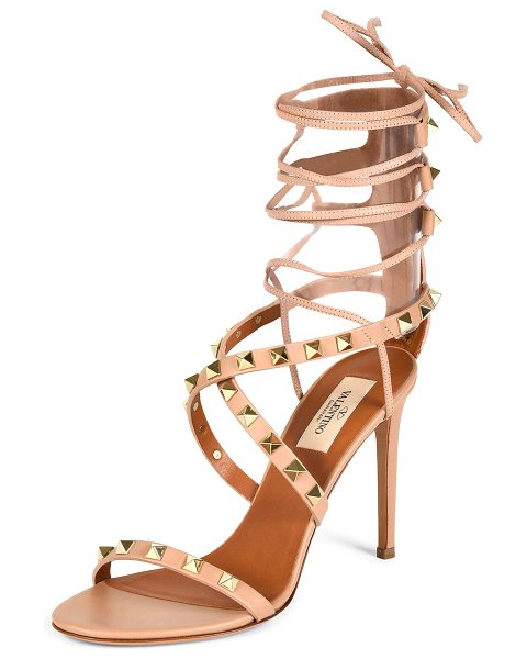"Valentino Rockstud crisscross ankle-wrap sandal in skin sorbet - Valentino leather sandal with Rockstud trim. 4"" covered..."