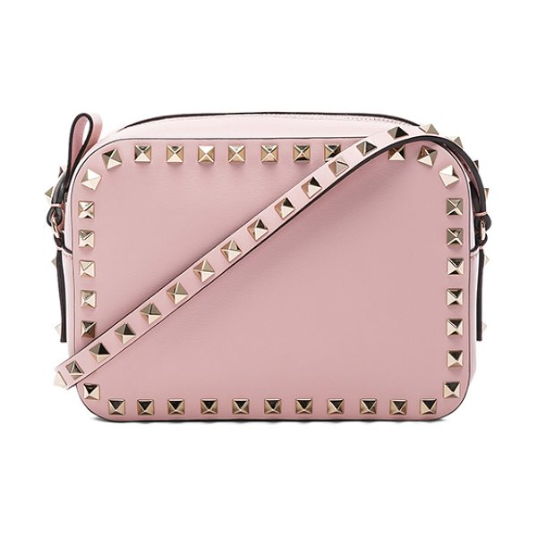 """Valentino Rockstud Crossbody Bag in pink - """"Genuine leather with canvas lining and gold-tone..."""
