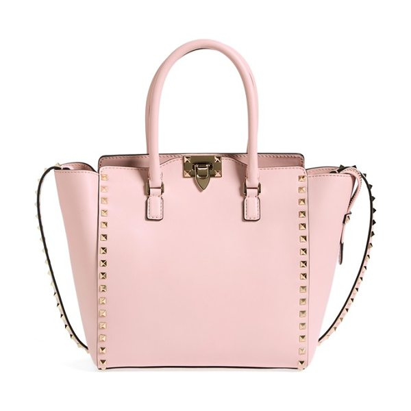 Valentino Rockstud double handle leather shopper in water rose - Iconic pyramid studs frame a structured Italian tote...