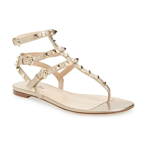 Valentino rockstud gladiator sandal in metallic leather - Regimented rows of pyramid studs punctuate the...