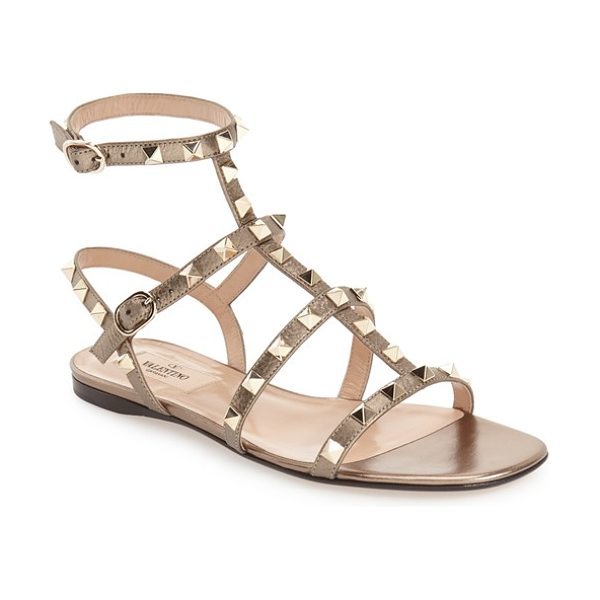 VALENTINO 'rockstud' gladiator sandal - Golden pyramid studs punctuate the Italian leather...