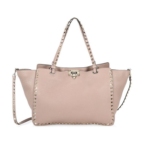 Valentino medium rockstud leather tote in poudre - Signature rockstuds frame pebled leather finish of this...