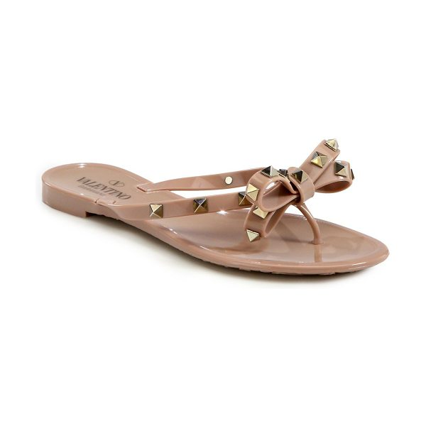 VALENTINO rockstud jelly thong sandals in blush - Jelly bow flip flop sprinkled with signature studs....