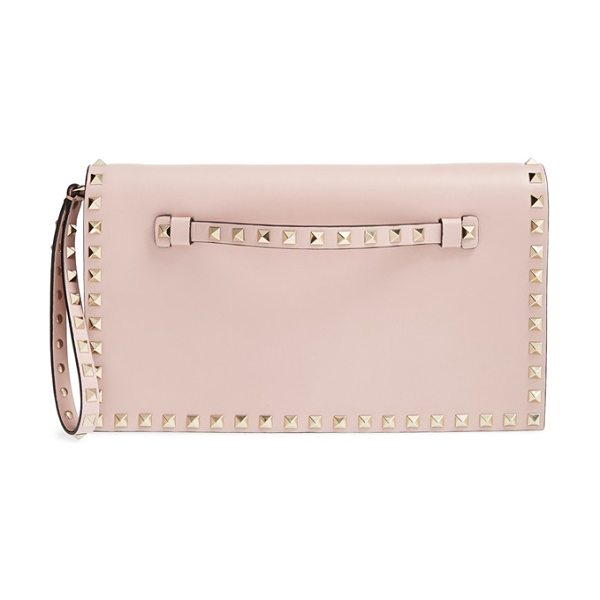 VALENTINO Rockstud leather clutch - Iconic pyramid studs toughen up a pastel-hued flap...