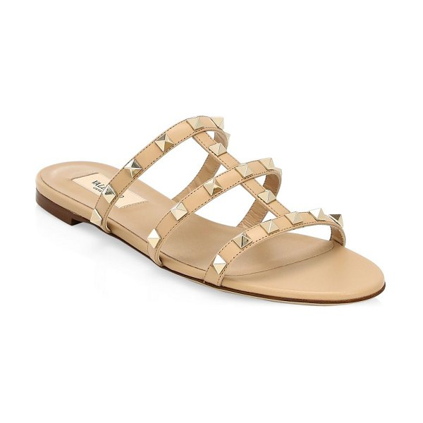 Valentino rockstud leather flat sandals in camel
