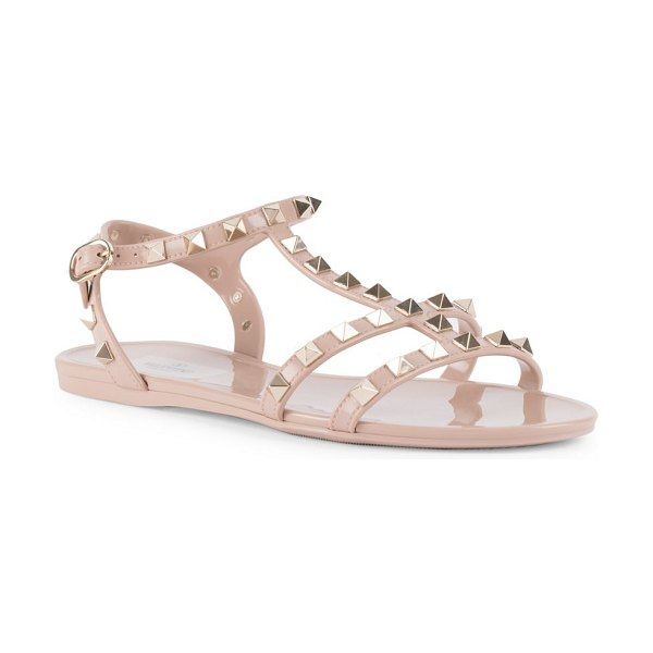 Valentino rockstud leather gladiator sandals in powder - Iconic rockstuds elevate these gladiator sandals to...