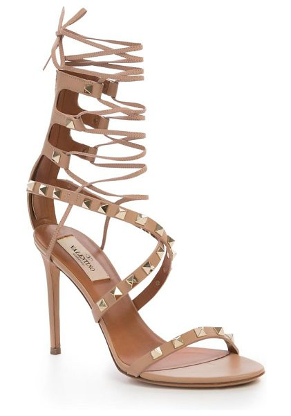 Valentino Rockstud leather lace-up gladiator sandals in nude - Signature rockstuds polish leather lace-up...