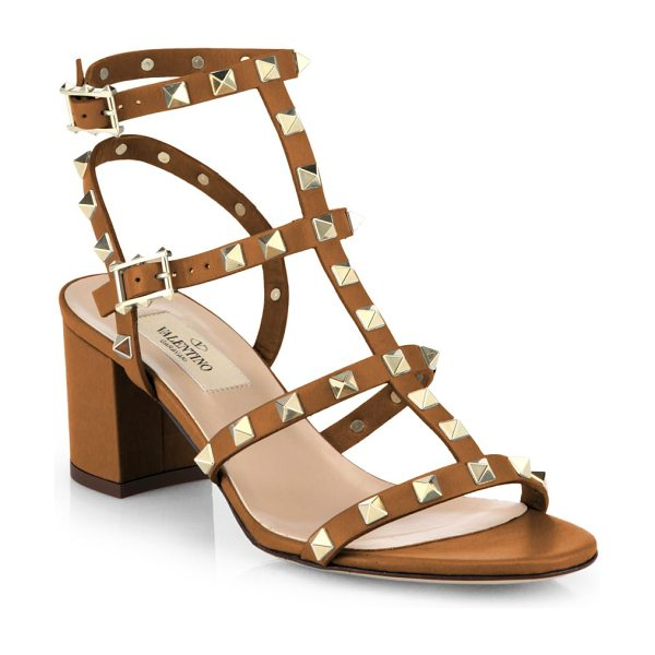 Valentino Rockstud leather sandals in darkcognac - Meticulously tailored leather T-strap silhouette with...