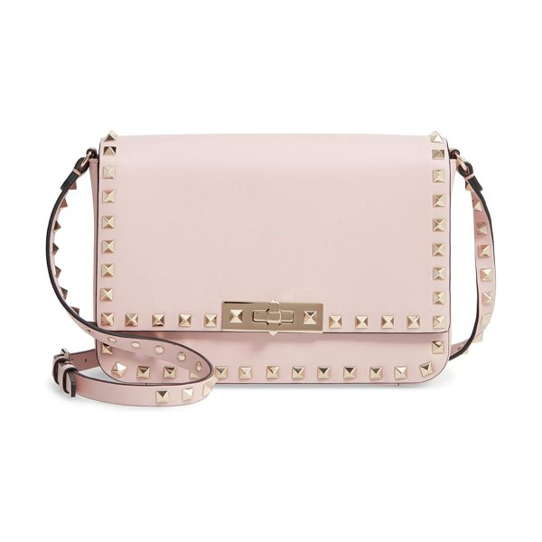 Valentino rockstud leather shoulder bag in pink - Signature rockstuds trace the structured silhouette of a...