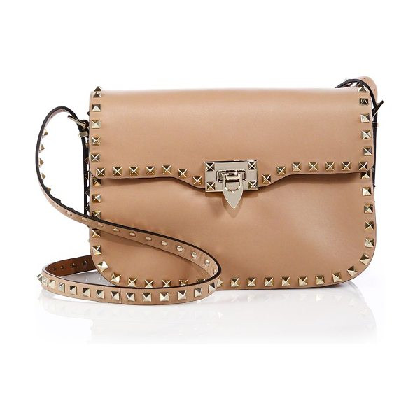 Valentino Rockstud leather shoulder bag in taupe - Valentino's iconic pyramid studs trace the sleek...