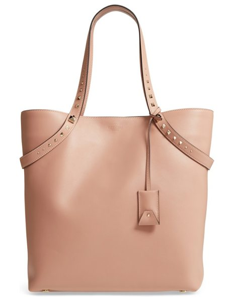Valentino rockstud leather tote in nude - Straps accented with graduated pyramid studs drape...