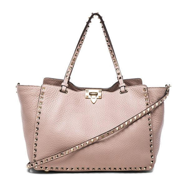 VALENTINO Rockstud medium crossbody tote - Grained leather with raw lining and gold-tone hardware. ...
