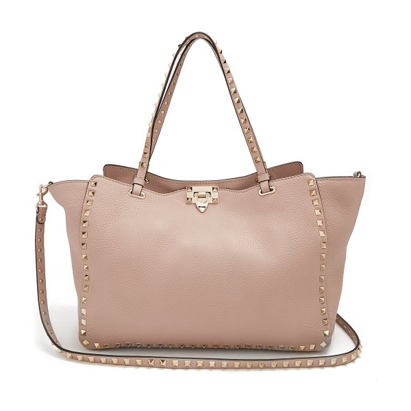 Valentino rockstud medium leather tote in nude - Valentino - For a standout style with everyday utility,...