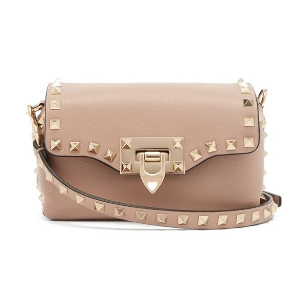 Valentino rockstud mini leather cross body bag in nude - Valentino - Valentino's mini cross-body bag has been...