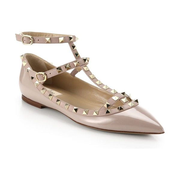 Valentino rockstud patent leather cage flats in blush - Signature rockstuds decorate classic patent cage flat....
