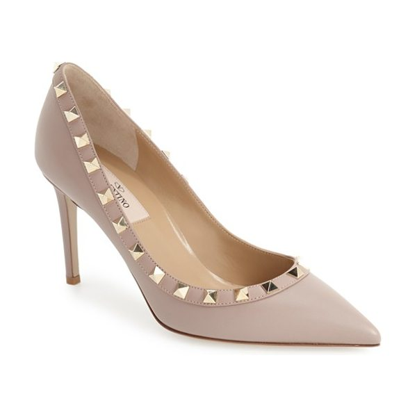 Valentino rockstud pointy toe pump in poudre leather - Signature pyramid studs gleam along the calfskin-trimmed...