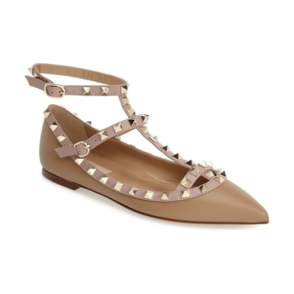 VALENTINO rockstud t-strap flat - Signature pyramid studs trace the topline and caged...