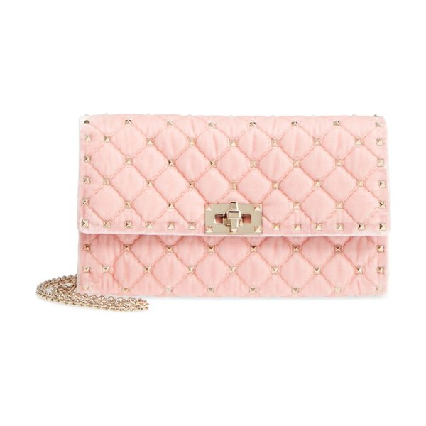 VALENTINO rockstud velvet clutch in pink - Iconic pyramid studs toughen up a lush velvet clutch...