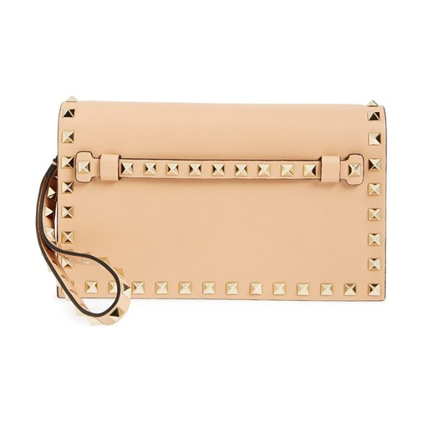 Valentino Small rockstud leather flap clutch in skin sorbet - Whether you want to add an opulent edge to casual...