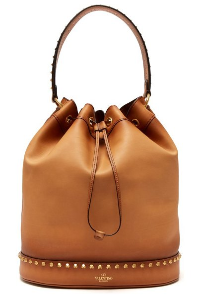 Valentino twinkle studs leather bucket bag in tan - Valentino - Burnished leather lends Valentino's tan...