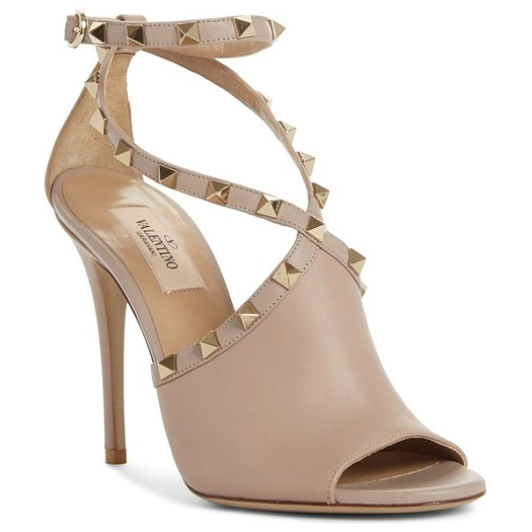 Valentino rockstud peep toe sandal in beige - A mule-inspired detail at the vamp stops short at the...