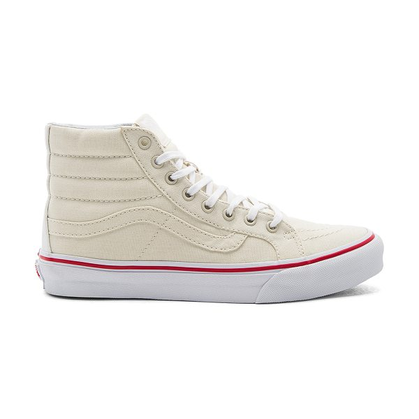 Vans SK8-Hi Slim Sneaker in cream - Canvas upper with rubber sole. Lace-up front. Padded...
