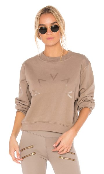 Varley Albata Sweatshirt in taupe - 100% cotton. Screen print graphic. Banded edges....