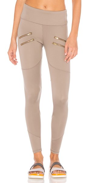 Varley Palms Legging in taupe - 70% polyamide 30% elastane. Stretch fit. Gold tone...