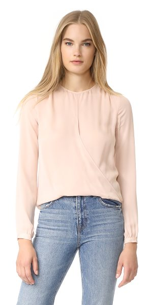 Veronica Beard logan surplus top in blush - A draped front panel and uneven hem relax the fit of...