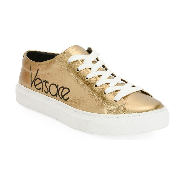 Versace Metallic Logo Platform Low-Top Sneakers in gold - Versace metallic calf leather sneaker with logo...