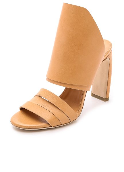 VIC MATIE Banana heel mules in natural - Vic Matie mules have sculptural appeal with a slim,...