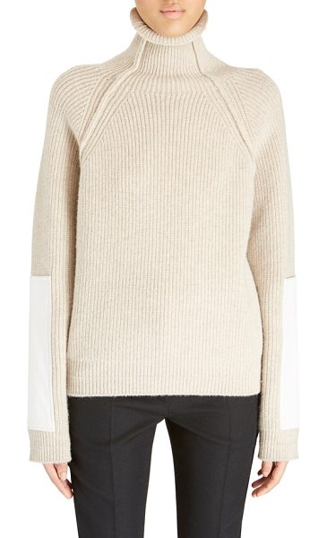 VICTORIA BECKHAM sleeve patch wool turtleneck in tan - Oversized patches along the forearms provide modern...