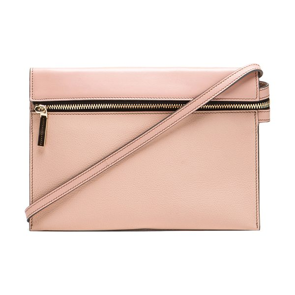 Victoria Beckham Zip pouch cross body in pink - Calfskin and buffalo leather features canvas lining with...