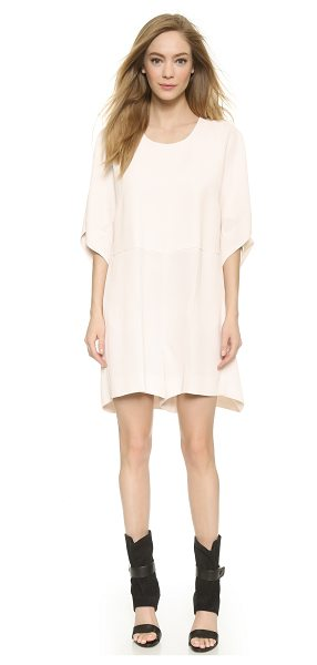 Viktor & Rolf Short sleeve romper in cream - An exaggerated silhouette puts a modern spin on a...