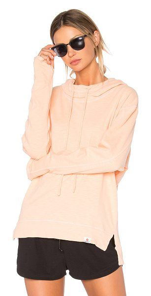 Vimmia Renew Hoodie in peach - 100% cotton. Drawstring hood. Cut-out thumb holes. Slit...