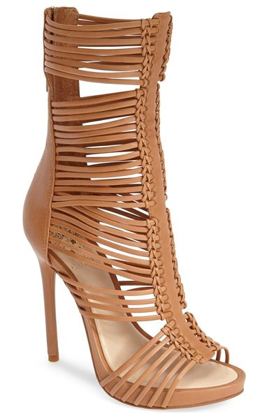 VINCE CAMUTO barbara strappy caged leather sandal in tan - Slender leather straps weave through a centerpiece set...