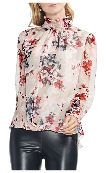 Vince Camuto blooms smocked ruffle neck crinkle blouse in dune lily - A smocked neck and cuffs sprouting effusive ruffles add...