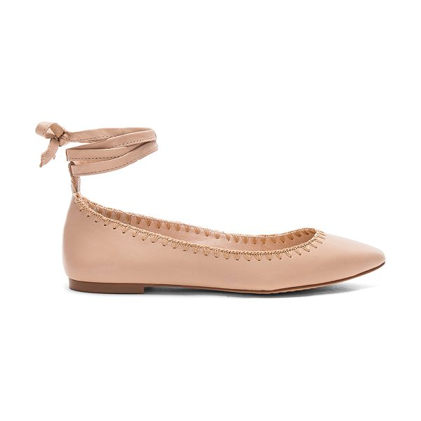 Vince Camuto Braneeda Flat in beige - Leather upper with man made sole. Wrap ankle with tie...